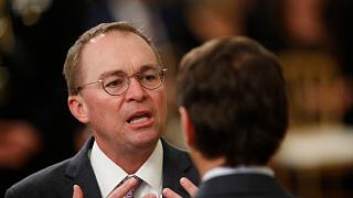 White House acting chief of staff Mick Mulvaney mingles with other attendees in the in the East Room of the the White House in Washington, Thursday, Feb. 6, 2020, before Presi