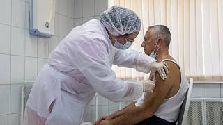 Sept. 15, 2020, file photo, a Russian medical worker administers a shot of Russia's experimental Sputnik V coronavirus vaccine in Moscow, Russia