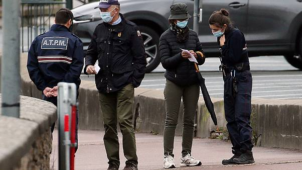 Police officers check documents to ensure that confinement measures due to the coronavirus are upheld in Saint Jean de Luz on Nov.3, 2020.