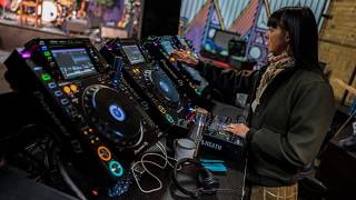A DJ prepares her decks at a Berlin club back in March 2020
