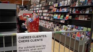 A barrier prevent customers to buy books in a supermarket of Saint Pee sur Nivelle, southwestern France, Tuesday, Nov.3, 2020.