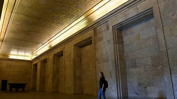 A visitor stands at the Goldener Saal (golden hall) inside the Zeppelintribuene granstand at the Zeppelinfeld (Zeppelin field)
