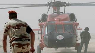 Multinational Force and Observers (MFO) helicopter and personnel work at the site of the French military transport aircraft crash in the Sinai region of Egypt in 2007