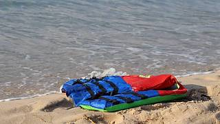 In these photos taken Nov. 12, 2020, life jackets litter the beach off the coast of Libya near the port of al-Khums.