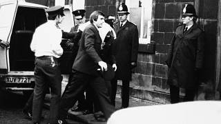 Peter William Sutcliffe (blanket on head) in Dewsbury in February 1981, where at the Magistrates Court he was committed in custody for trial on 13 counts of murder.