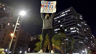 People celebrate at Pershing Square the victory of President-elect Joe Biden and Vice President-elect Kamala Harris in Los Angeles