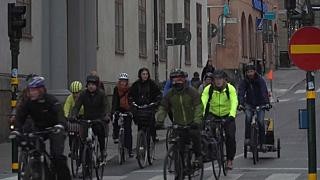 Cyclists commute through central Malmo