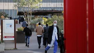 Dr Philippe Montravers arrives at the Bichat Hospital in Paris, Nov. 10, 2020. Montravers and the 150 doctors and nurses he leads have become experts on treating COVID-19.