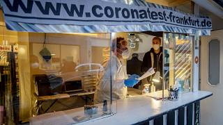 Dr Georg Siemon offers COVID tests with a result in 20 minutes from a kiosk given up by its owners due to the pandemic, Frankfurt, Germany, Wednesday, Nov. 11, 2020.