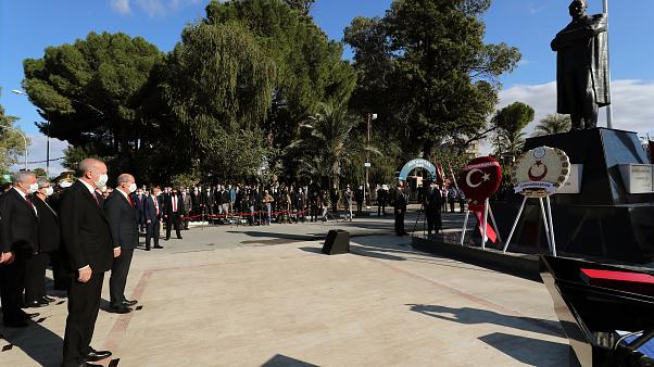 Turkish President Recep Tayyip Erdogan (front,L) and Turkish Cypriot leader Ersin Tatar (front, R) laying wreath to the statue of Mustafa Kemal Ataturk, Nicosia, Nov. 15, 2020