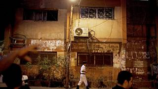 An Egyptian police officer stands outside a polling station in the Abdeen area of Cairo, Egypt on Sunday, June 17, 2012