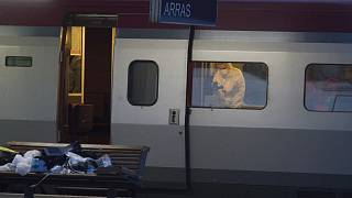A police officer videos the crime scene inside a Thalys train at Arras train station, northern France, after a gunman opened fire with an automatic weapon.