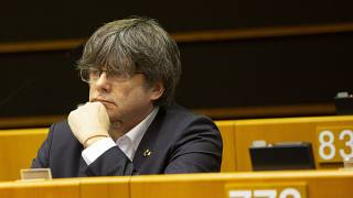 Catalonia's former regional president and MEP Carles Puigdemont listens during a session in the Plenary chamber of the European Parliament in Brussels