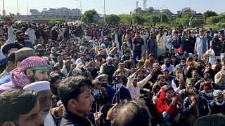 Supporters of Tehreek-e-Labaik Pakistan, a religious political party, block a main highway during an anti-France rally in Islamabad, Pakistan, Monday, Nov. 16, 2020.