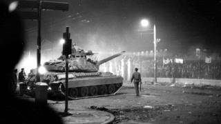 In this Nov. 17, 1973 file picture, army tanks prepare to drive through the gates of the Polytechnic Institute in Athens.