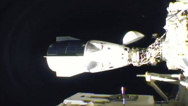 In this frame grab from NASA TV, the SpaceX Dragon is seen after docking at the International Space Station, late Monday, Nov. 16, 2020.