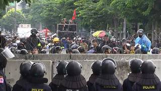 People protesting in front of policemen