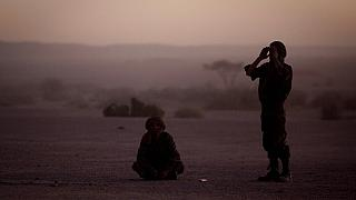 FILE - In this Feb.27, 2011 file photo, pro-independence Polisario Front rebel soldiers pray after sunset in the Western Sahara village of Tifariti.