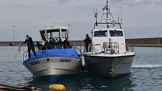 A vessel with migrants arrive after an operation by the Greek Coast guard