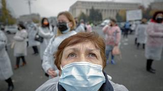 A medical worker, wearing a mask for protection against the COVID-19 infection