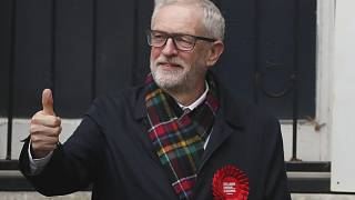 FILE - In this Thursday, Dec. 12, 2019 file photo, British opposition Labour Party leader Jeremy Corbyn, gestures after casting his vote in the general election