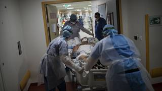 A COVID-19 patient is transferred to the main ICU at the La Timone hospital in Marseille on Thursday, Nov. 12, 2020.