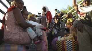 Ethiopian refugees gather in Qadarif region, easter Sudan, Tuesday, Nov. 17, 2020.