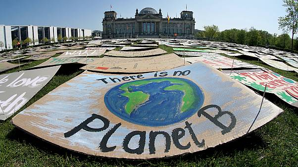Activists place thousands of protest placards in front of the Reichstag building in Berlin on April 24, 2020.