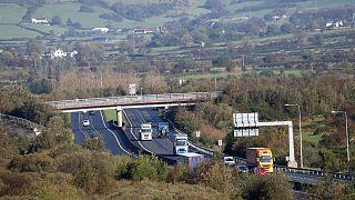 Motorists on the M1 motorway crossing the Irish border near Jonesborough, Republic of Ireland, looking across the border into Northern Ireland, Wednesday, Oct. 16, 2019.