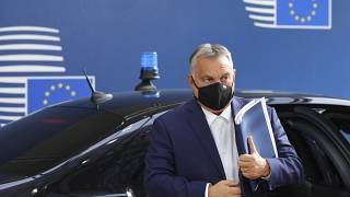FILE - In this Oct. 15, 2020, file photo, Hungary's Prime Minister Viktor Orban arrives for an EU summit at the European Council building in Brussels.