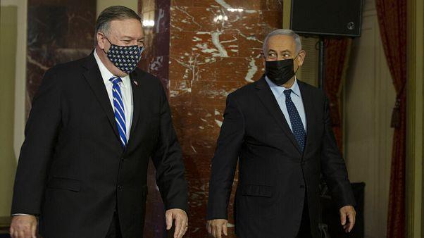 US. Secretary of State Mike Pompeo, left, and Israeli Prime Minister Benjamin Netanyahu leave after making a joint statement in Jerusalem, Thursday, Nov. 19, 2020