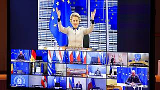 European Commission President Ursula von der Leyen, top, gestures as she talks with EU leaders during an EU Summit video conference at the European Council building.