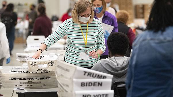 An election worker in Georgia sorts through ballots during a Cobb County hand recount of presidential votes on Sunday, November 15, 2020.