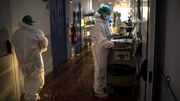 Nurse Marta Fernandez works at the COVID-19 ward at the hospital del Mar in Barcelona, Spain, Wednesday, November 18, 2020.