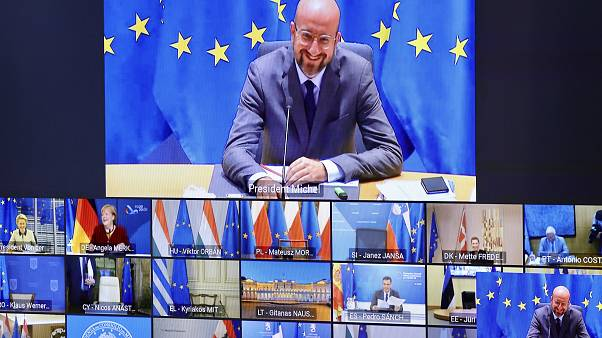 European Council President Charles Michel, top, talks with EU leaders during an EU Summit video conference at the European Council building in Brussels, Nov. 19, 2020