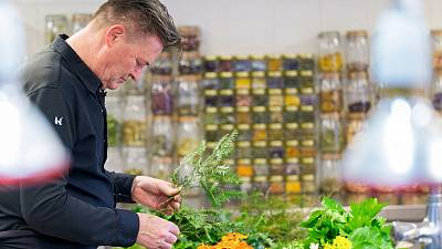 Belgian Rene Mathieu, chief of La Distillerie, prepares vegetables in the kitchen of the  restaurant at Bourlinsgter's castle.