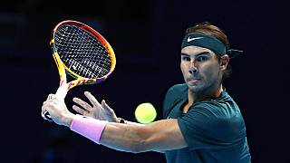 Rafael Nadal of Spain returns the ball to Stefanos Tsitsipas of Greece during their tennis match at the ATP World Finals.