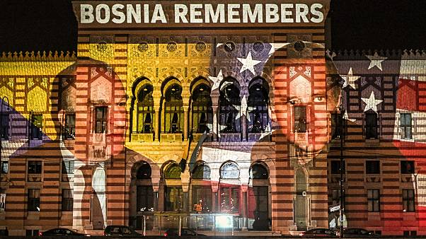 A of photograph US President-elect Joe Biden and Bosnia's first President Alija Izetbegovic is projected on the National Library building in Sarajevo, Bosnia on Nov 8, 2020.