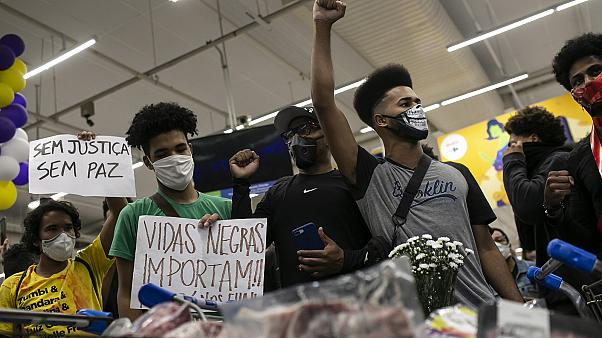Activists including members of Black Lives Matter demonstrate inside a Carrefour supermarket against the murder of black man Joao Alberto Silveira Freitas.
