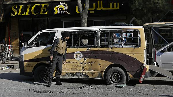 Afghan security checks a car destroyed in a rocket attack in Kabul, Afghanistan,Saturday, November 21, 2020.