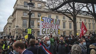 Demonstrators wearing masks stage a protest by the National Assembly against the security bill in Paris, Tuesday, November 17, 2020.