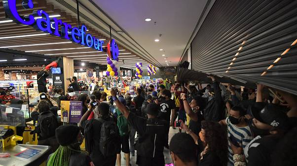 Demonstrators invade a supermarket Carrefour in Sao Paulo.