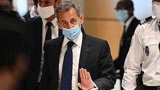 Former French president Nicolas Sarkozy arrives at the Paris court house to hear the final verdict in a corruption trial on March 1, 2021