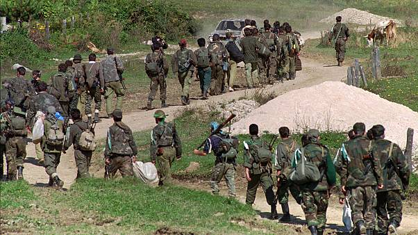 In this Sept. 28, 1995. file photo, a line of Bosnian government troops makes its way to the front-line near Mrkonjic Grad 120kms (80mls) north west of Sarajevo, Bosnia.