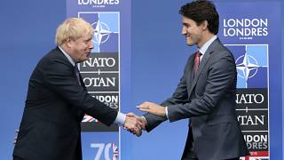 UK Prime Minister Boris Johnson (L) and Canadian Prime Minister Justin Trudeau during official arrivals for a NATO leaders meeting on Dec. 4, 2019.