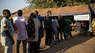 People line up to vote in Burkina Faso's presidential and legislative elections in Ouagadougou Sunday November 22, 2020.