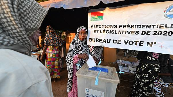 A voter casts her ballot at a polling station in Ouagadougou, during Burkina Faso's presidential and legislative elections.