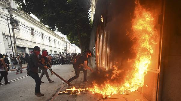 Demonstrators set on fire part of the Congress building during a protest demanding the resignation of Guatemalan President Alejandro Giammattei.