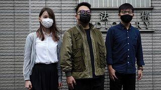 Hong Kong activists, from right, Joshua Wong, Ivan Lam and Agnes Chow at a court in Hong Kong, Monday, Nov. 22. 2020.