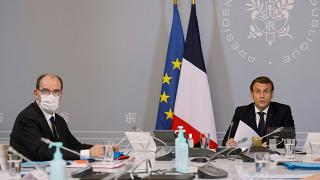 President Emmanuel Macron, right, speaks next to French Prime Minister Jean Castex, left, during a videoconference in Paris, November 17, 2020.